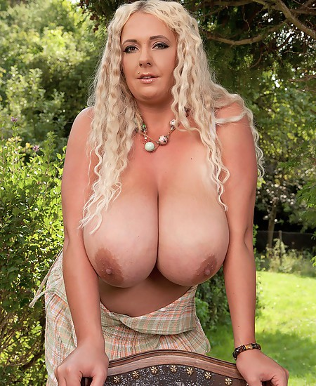 Hot blonde whore with enormous boobs